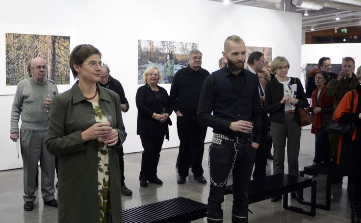 Evening of the exhibition opening for photographer Ritva Kovalainen and painter Sampsa Sarparanta.
