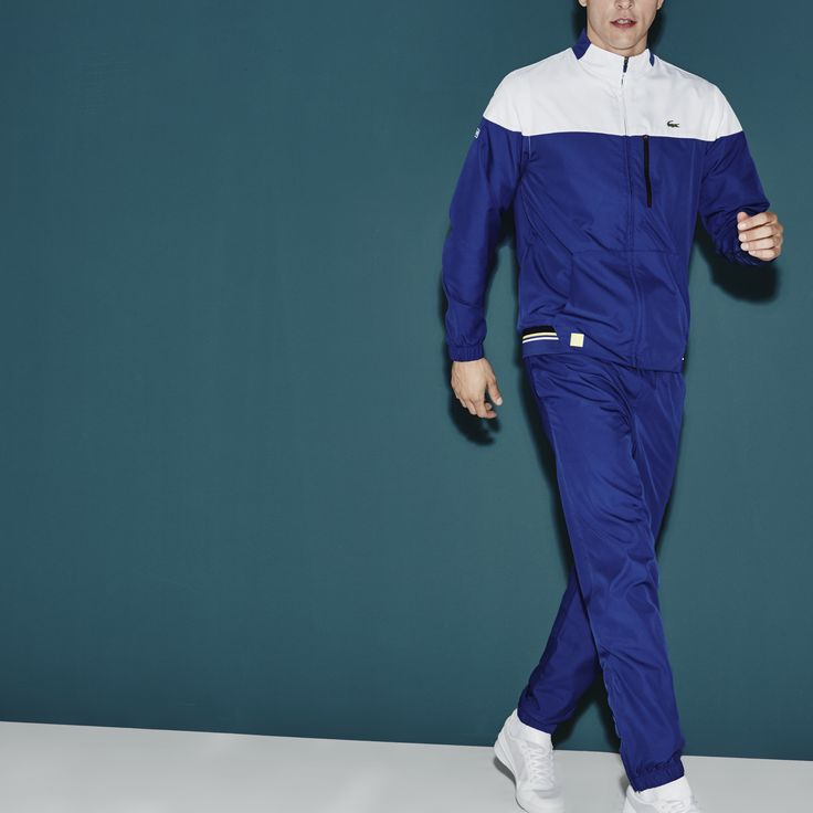 Keep warm and comfortable as you play with this Lacoste Sport tracksuit. Colored accents and a colorblock design complete the stylish sporty look.