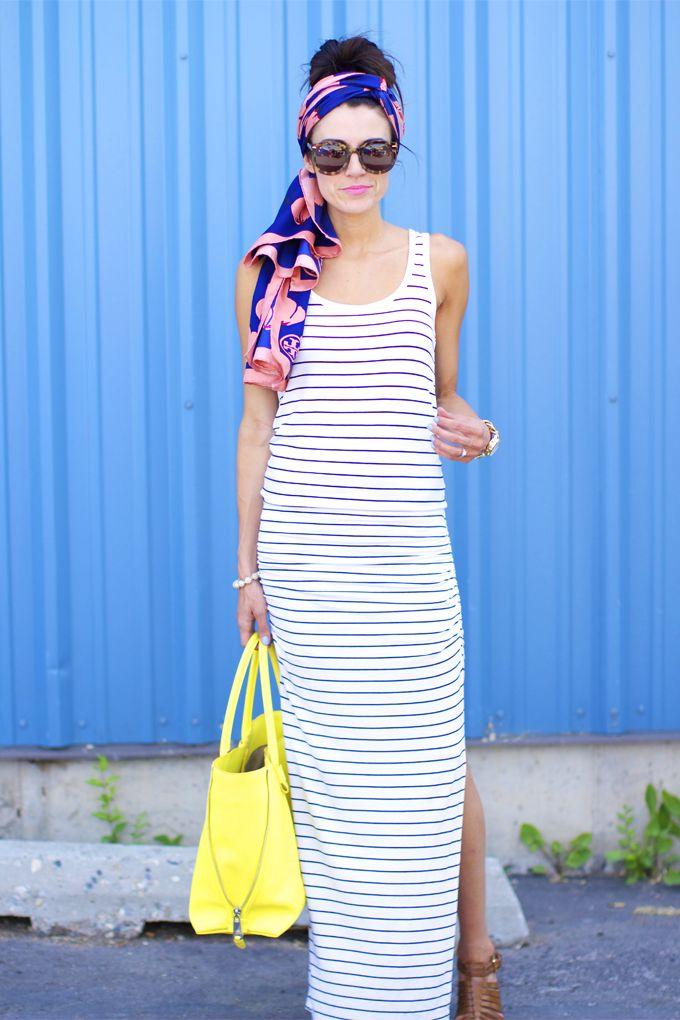 Striped maxi dress, fun printed head scarf, and a bright statement bag!