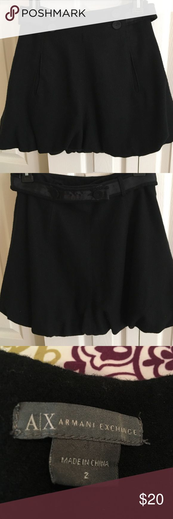 Size 2 Armani Exchange bubble skirt. Size 2 Armani Exchange black bubble skirt.  50% wool. 30% polyester, and 20% viscose.  Lining 100% polyester. Zips up side and buttons to back. A/X Armani Exchange Skirts