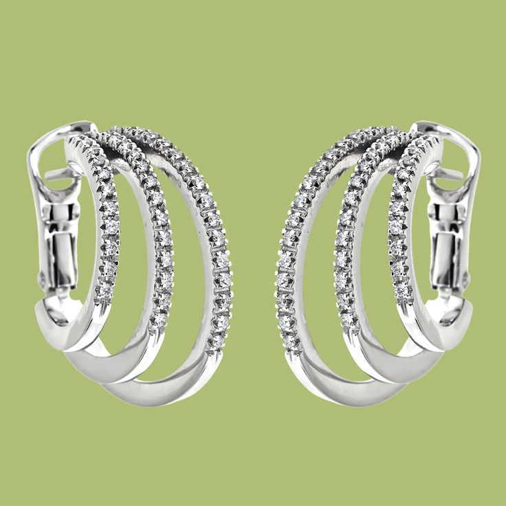 These Dazzling White Gold Huggie Earrings Showcasing Three Half Circles Lined Up With Of Sparkling Round Diamonds In An Elegant And Eye Catching Design