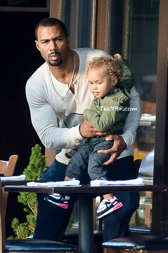 Omari Hardwick taking care of his daughter. 2012. Fatherly love. Biracial child.