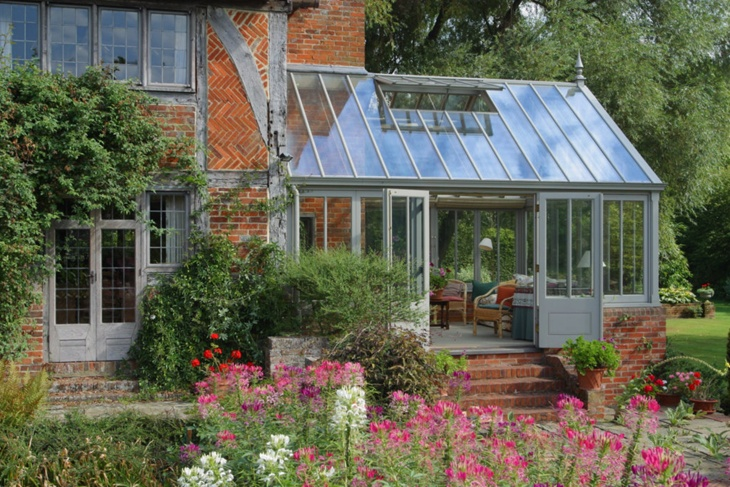This quintessential Victorian style conservatory fits beautifully with the sixteenth century house.