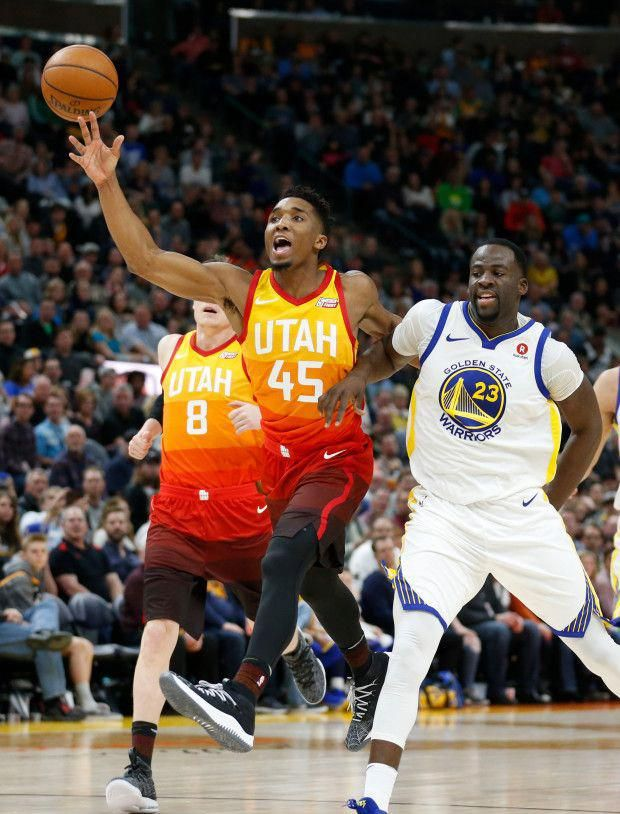 b5fc073f8ae7 Utah Jazz guard Donovan Mitchell (45) is fouled by Golden State Warriors  forward Draymond Green (23) in the second half during an NBA basketball  game ...