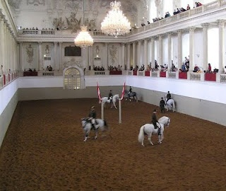 "AUSTRIA...... VIENNA. The Spanish Riding School (de: Spanische Hofreitschule, the ""Spanish Court Riding-School""), is a traditional riding school for Lipizzan horses, which perform in the Winter Riding School in the Hofburg."