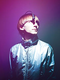 Neil Harbisson - born with achromatopsia (a condition that only allows him to see in black and white).  He has a chip implanted in his skull that is connected to a camera.  This enables him to translate color into sound and vibration
