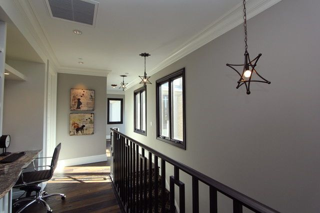 : Mesmerizing Contemporary Hall Design With Dark Brown Colored Wooden Handrail And Several Black Star Pendant Light