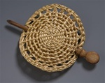 """Rebecca Brewer of Cordova, Alaska creates lovely hand-woven hair ornaments of spruce root and yellow cedar bark, accented by hand carved cedar sticks. Her materials are gathered locally and each piece is original. Approximately 4"""" in diameter."""