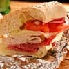 Baked Italian Heroes...Load the meats and cheeses onto Baked Italian Heroes. Drizzle these submarine sandwiches with Italian dressing, and hope that you've got giant appetites waiting!
