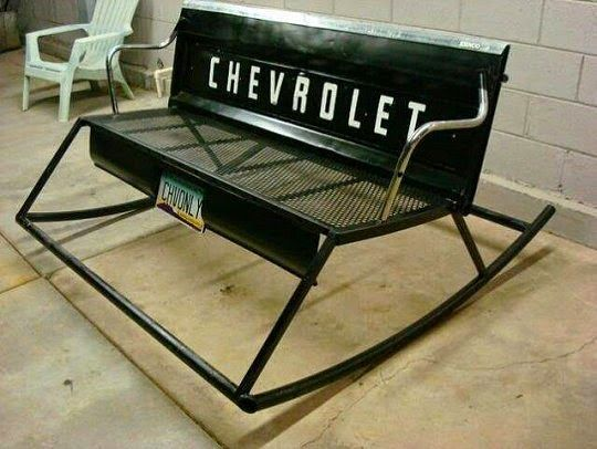 Outdoor rocking bench made from an old tailgate.
