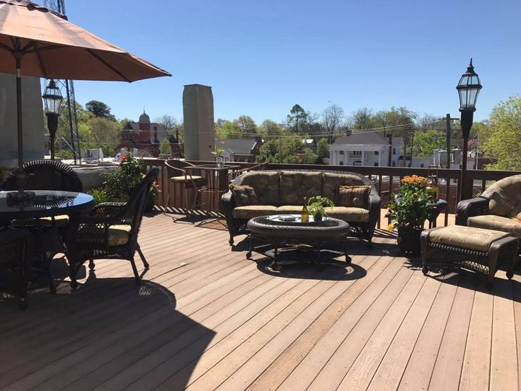 This is the patio of an apt above a store (Bee Southern) overlooking the town square of Washington, Ga. The Apt is on the Georgia Realty website and is a beautiful home ~ wish I could buy it!.