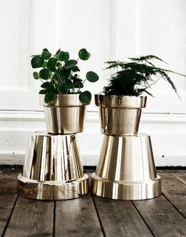 Silver spray paint on terra cotta flower pots