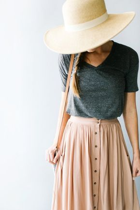 Feminine meets practical in this sweet button-down skirt with front pockets and a softly gathered waist. An attached slip means no layering required! Available in Taupe and Navy. Due to popular demand