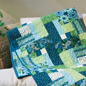 Love the colors on this one and the pattern too!~ Tribecca: Quick Modern Two Block Lap Quilt Pattern