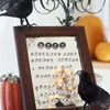"""Serving Up Scary  ( menu idea for a Halloween Party ) -  Whet your guests' appetites with an eerie menu. Give party foods Halloween-inspired names. (For example, fondue becomes """"Demon Dip."""") Use scrapbooking letter stickers to spell the newly named dishes on an old mirror, and display the menu on a plate stand. Surround with Halloween decorations, such as ravens and pumpkins."""