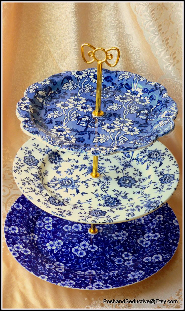 Based on selection of the best English made china brands: Burleigh Blue Calico, Jacobean in striking blue and white floral pattern this exquisite three tier handmade cake stand will add real statement of style to your tea party... It's only one of my samples of work which I am proud of to present. For more inspiring tea ceremony accessories from the heart of Cambridge, please, visit my boutique Posh and Seductive Etsy shop. You'll be warmly welcomed. #cakestand #blueandwhite #Englishchina