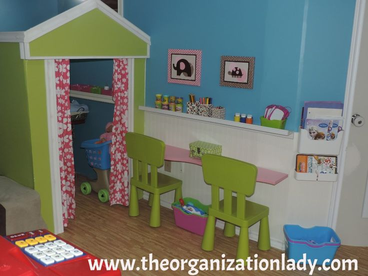This craft corner is an Ikea Hack special! The pink curved shelf (Which is unfortunately no longer available)  made for the perfect table, the picture ledge keeps crayons, markers, paints and other crafty items neat, tidy and within easy reach, while the wall mounted office organizer is an awesome paper storage solution!