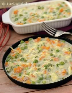 A healthy version of vegetable au gratin. The veggies are cooked in a creamy sauce in which the creamy texture is retained by the use of low calorie white sauce made with cauliflower puree instead of high fat butter. Small portions of such healthy main courses can support weight loss by taking of the edge off your appetite so you won't overeat at mealtimes.