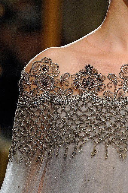 Lovely beading to emphasize the shoulders