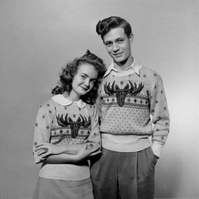 Over-the-moon fabulous matching his and hers 1940s moose head sweaters...    ~This is what is missing from our camping wardrobe!