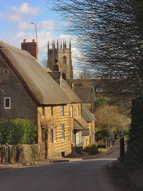 Hook Norton - Oxfordshire, England with the 11th century St Peter's Church in the background, unusual in that the font features pagan signs of the Zodiac