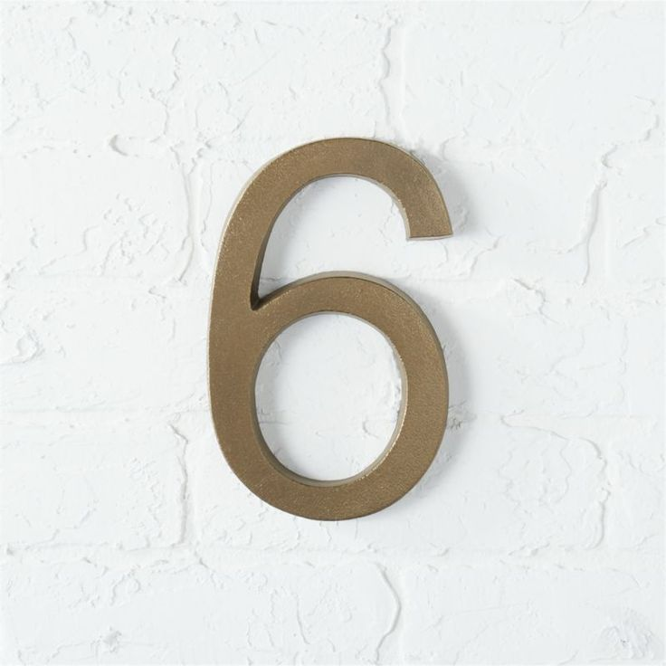 Shop bronze house number 6.   Handmade numbers announce your address in a modern arial font and textured bronze finish.  Easy to spot from a distance.  Ups your curb factor, too.  Flush mount or leave screws partially out for a floating number effect.