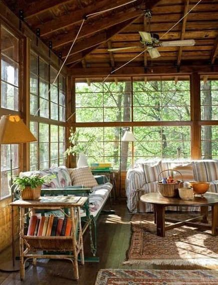 vintage lake house porch with antique windows – oldhouseonline via atticmag