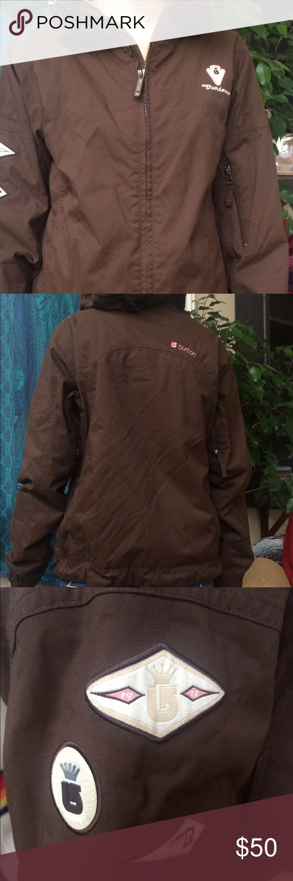 Brown Burton Ski Jacket Burton Ski Jacket with pink and gold accents and a gold interior. Has air vents on the arms for air flow. In great condition besides some wear by the left thumb hole as shown in the photos. Jacket has been priced accordingly :) Burton Jackets & Coats Utility Jackets