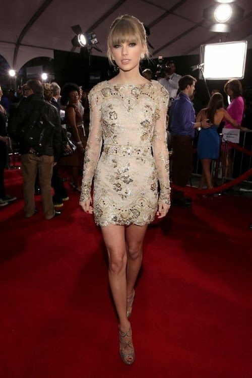 Magnificient nude textured gown on Taylor Swift