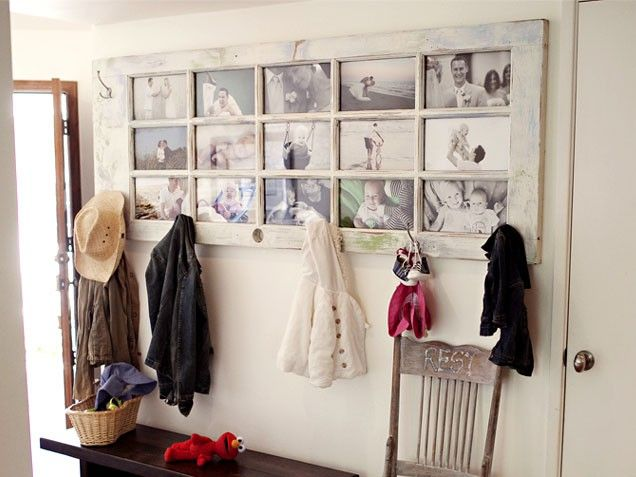 Why not use an old paned door as a frame for family pictures! This clever designer added hooks for keeping family's coats neat and tidy!  door decor. interior design. repurposed doors. picture frame. recycled design. vintage door.
