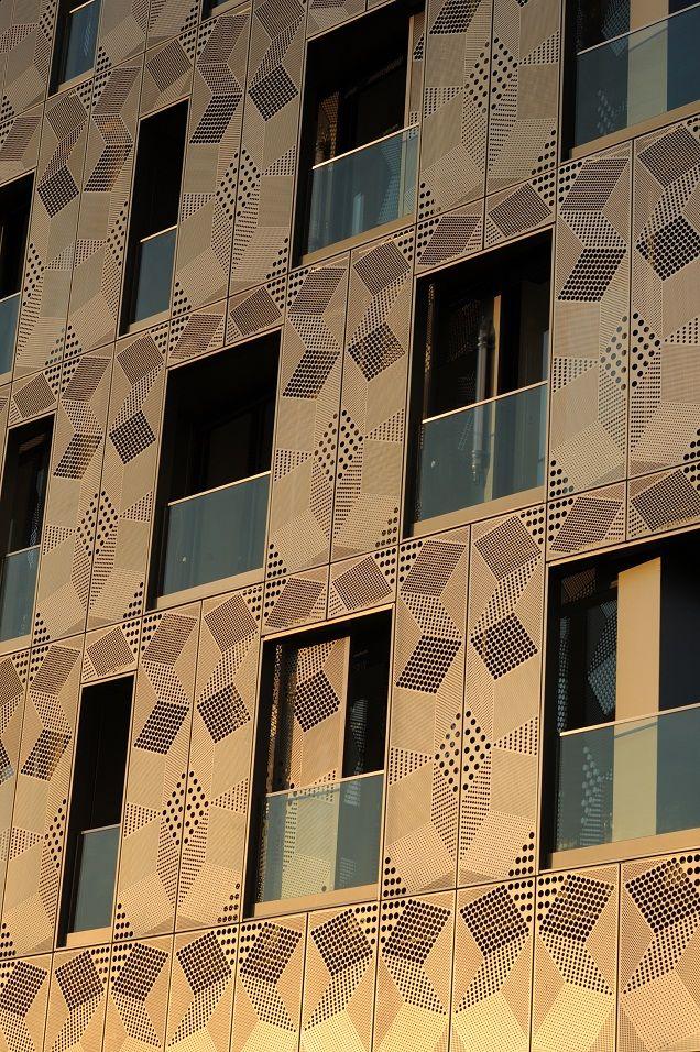 facade architecture metal Une façade en métal pour un immeuble flambant neuf : quartier Masséna à Paris