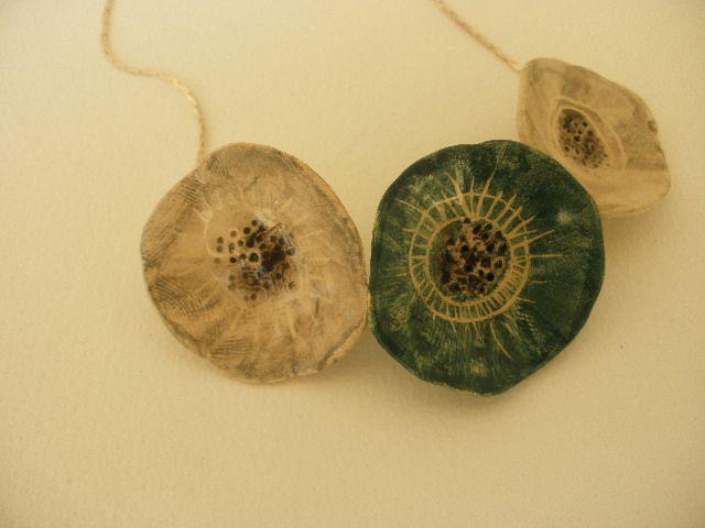 Anna Chronaki- short neckles with 3 ceramic flowers.
