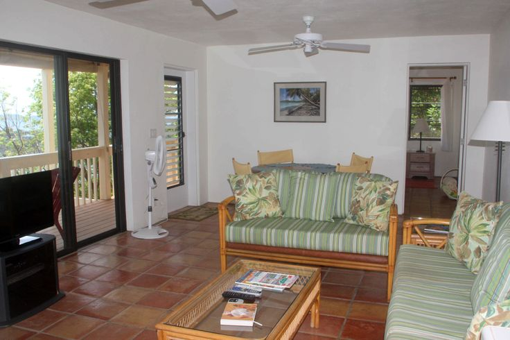 """Gaze out to the ocean views or catch up with the news on the 32"""" Flat Screen LCD TV.  A large round table with seating for four is spacious enough to enjoy meals inside if you need a break from the sun.  The living room, dining and kitchen areas are 27' X 13' with views from end to end."""
