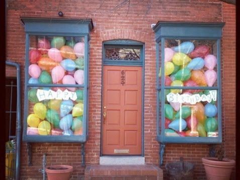 Love this idea of balloons in the window - looks like the house is full of balloons!