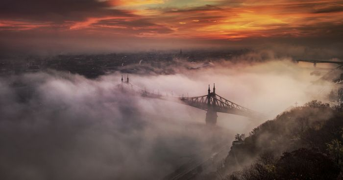 It is pretty rare in Budapest when the fog sits so low that the bridges and other buildings stick out from it. I have been chasing these special moments of the city for years. Take a look below to see the results!