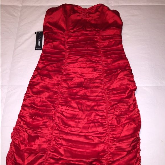 Red satin dress Great party dress! Satin red mini from Express. Size 0. Definitely gives a little, stretches a lot. Very comfortable. Express Dresses
