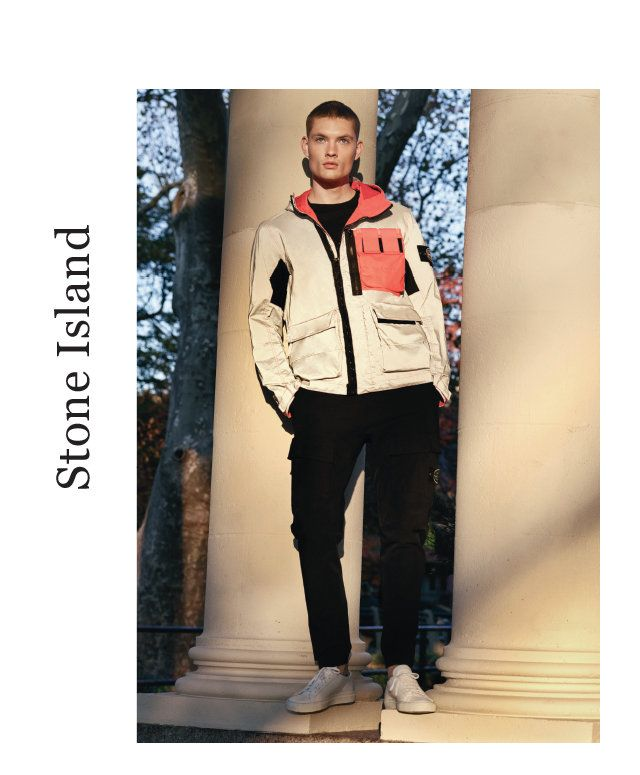 STONE ISLAND Reflective jacket in grey and coral pink. $1320. Jersey t-shirt. $175. Cotton and nylon stretch cargo. $475. Both in black.