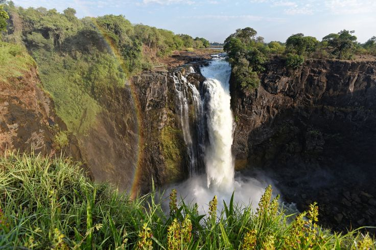 100 meters high Devils stream is on the Zimbabwe side of Victoria falls. (rainbow is not fault of lens or other mistake, it real rainbow :-) ) #africa #fall #huge #rainbow #river #victoria falls #water #zambezi #zambia #zimbabwe #devils stream