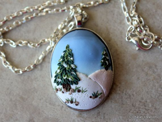 Lovely polymer clay pendant is intricately hand-sculpted and features a snowy landscape. The cabochon is mounted on silver finish bezel. The cabochon is 1.25 inches (32 mm) in diameter. It comes with a 25 inches long silver finish chain.  This is much more prettier in person! My photos fail to capture the beauty of this elegant and lovely pendant!  Each jewelry piece is made with great love, patience and passion to create something exquisite. No moulds are used to create the details. Each…