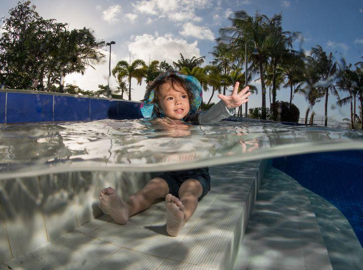 https://flic.kr/p/FiJPfB | Nanami-chan Waves Goodbye to Departing Bathers | My daughter Nanami enjoys the pool on a beautiful Guam afternoon.   Sigma 15mm fisheye lens, Nikon D800 in Nexus Housing, Ikelite strobes.