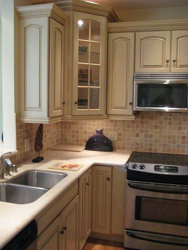 Google Image Result for http://www.kitchenbacksplashreview.com/Stone/Kitchen%2520Corner%2520with%2520Stone%2520Backsplash.jpg