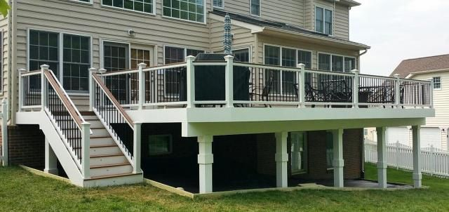 Decking in Trex Tiki Torch. Railing in white Trex Transcends with Tree House cocktail rail and black balusters in Ashburn, VA.