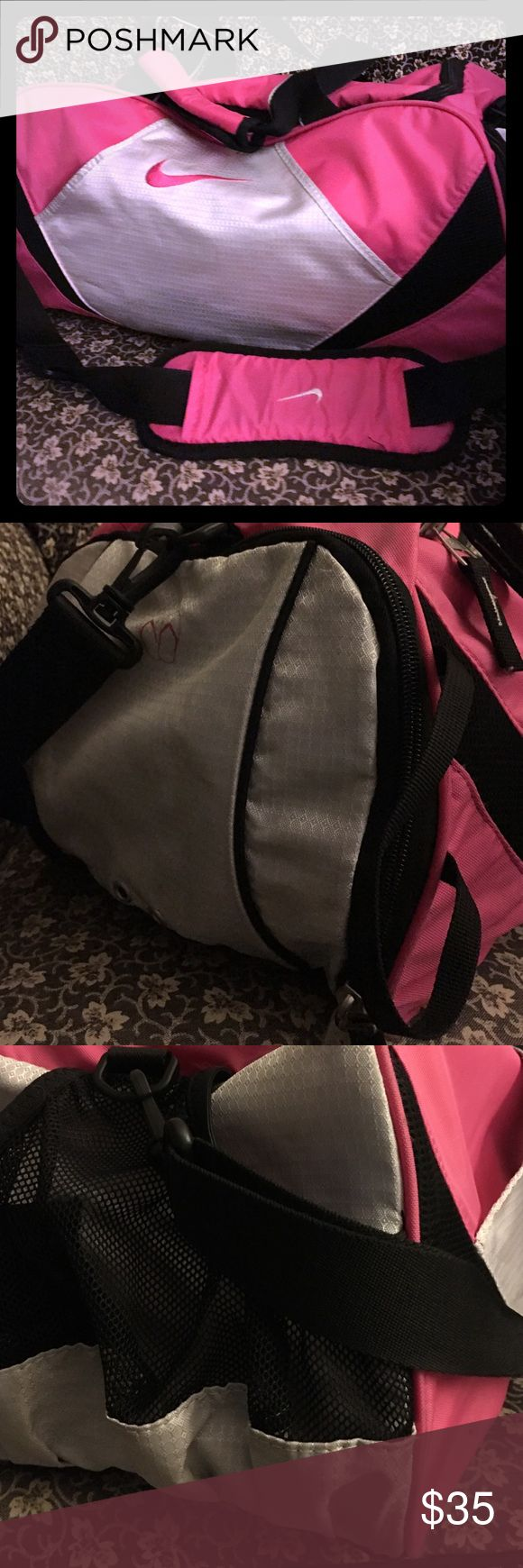NIKE EUC pink women's gym bag EUC NIKE gym bag only used a few times! In great condition looking for a new owner that will put it to use! 8+ pockets, shoe carrier, removable shoulder strap. Nike Bags Shoulder Bags