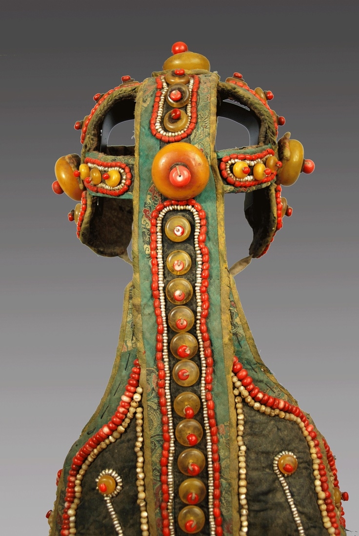 Tibet | Detail of the headpiece of a Shaman's robe | Silk, cotton, silver, amber, corral, pearls | 18th Century | Price on request