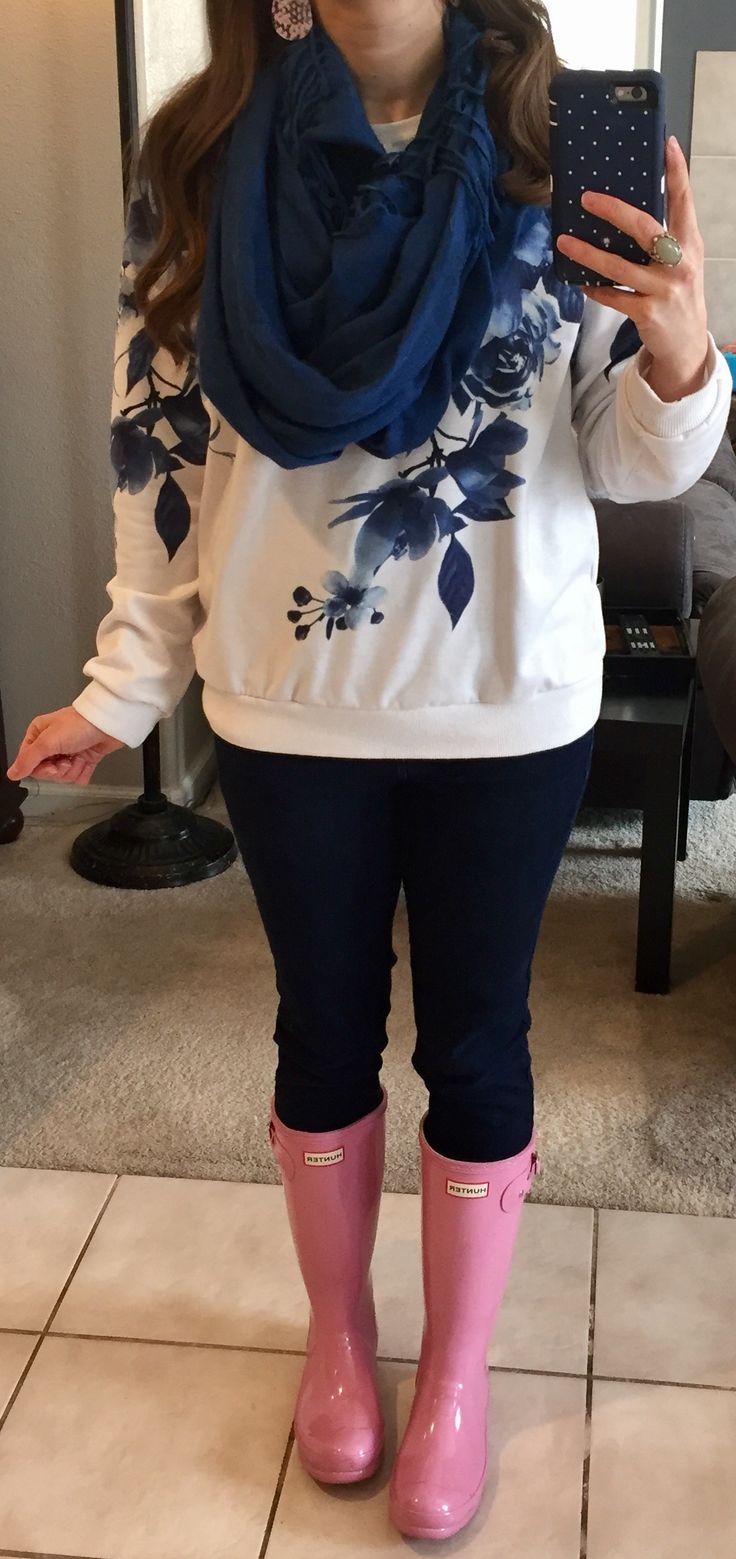 Navy scarf, navy and white floral sweatshirt, dark jeans, pink hunter rain boots.