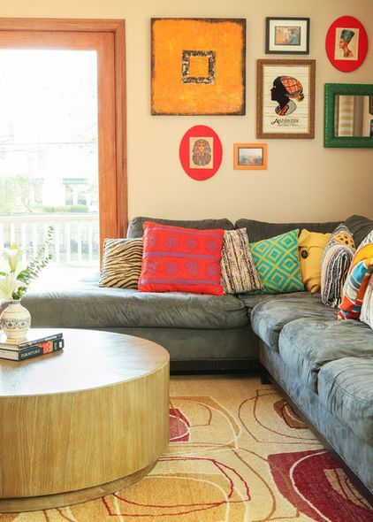 Grey Neutral Sofa With Lots Of Funky Colorful Pillows
