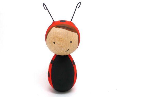 こけしのてんとう虫バージョンっ。可愛いです♪:Wooden Peg Doll Kokeshi Ladybug Girl by abbyjac on Etsy, $25.00