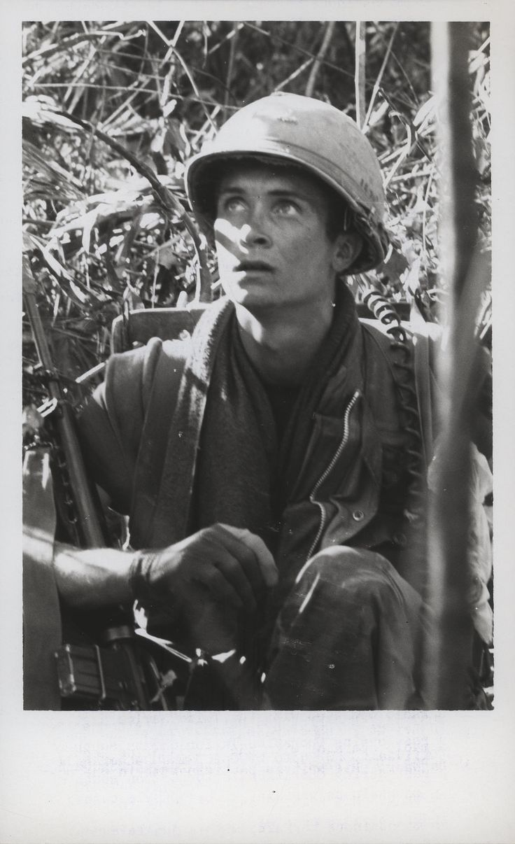 "Ron Heller Takes a Rest, 1968 ""Just Waiting: Private First Class Ron Heller, 19 (Altoona, Pennsylvania), a radio operator with the 3d Marines, takes a rest during Operation Taylor Common south of Da Nang. His unit is participating in the operation in mountainous terrain, with a jungle canopy 80 feet in height in some areas (official USMC photo by Corporal Mike Detherage)."" From the Jonathan Abel Collection (COLL/3611), Marine Corps Archives & Special Collections. OFFICIAL USMC PHOTOGRAPH"