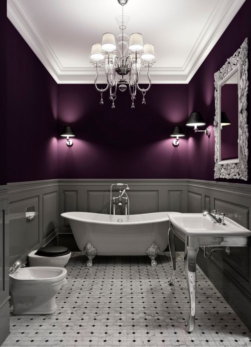 Have a bath, goth style. Elegant white and purple bathroom with claw tub and chandelier.