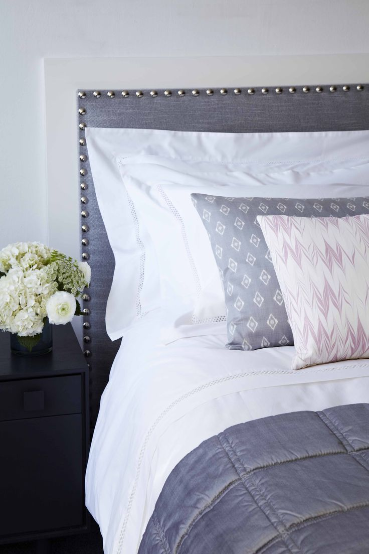 Silver silk ikat cushion and quilted bed runner with hand marbled silk cushion in soft lavender. All from Pad UK.